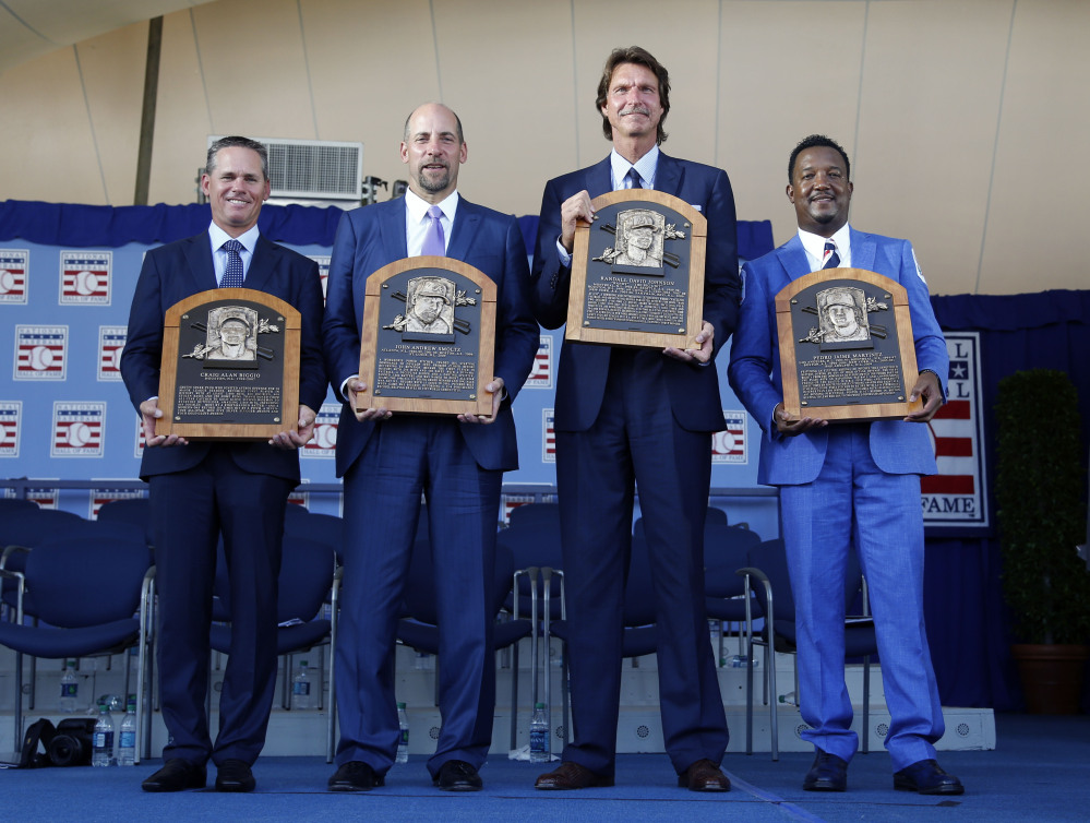 Newly inducted National Baseball Hall of Famers  from left: Craig Biggio, John Smoltz, Randy Johnson and Pedro Martinez hold their plaques after an induction ceremony.