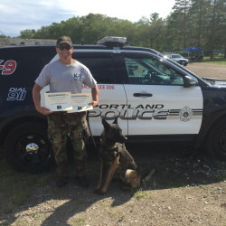 Portland Police Officer Christian Stickney and his canine partner, Blaze, after winning first-place overall in a competition in Raynham, Massachusetts, on Friday.