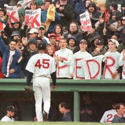 Pedro Martinez is cheered by fans in April 2001 after striking out the side against the Tampa Bay Devil Rays. The Boston Red Sox will install Martinez's No. 45 on the Fenway Park Facade on Tuesday night.