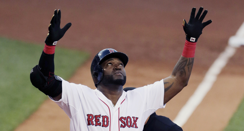 Celebrating or looking for help? David Ortiz raises his arms as he crosses home plate after his two-run home run in the first inning of Monday night's loss to the Chicago White Sox at Fenway Park.