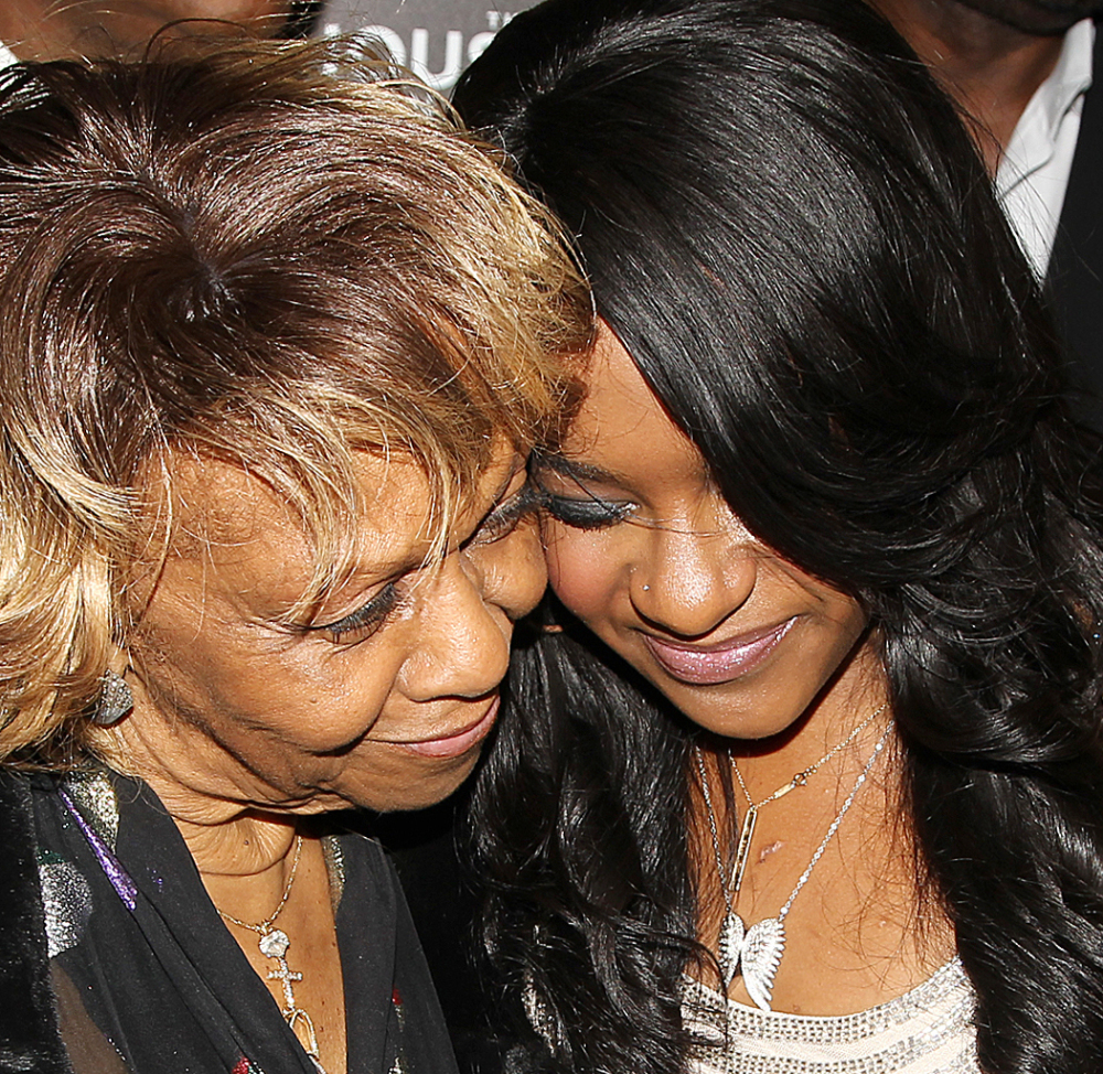 Cissy Houston stands next to granddaughter Bobbi Kristina Brown, who died at 22 Sunday after being placed in hospice care.