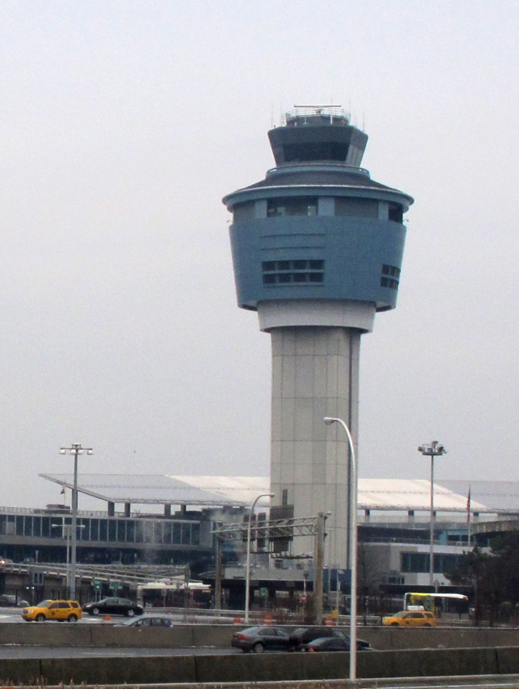 A control tower stands above cramped, outdated, high-traffic LaGuardia Airport in New York.