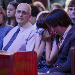 Jason Brown, right, husband of Jillian Johnson, who was killed in the Lafayette movie theater shootings, embraces his daughter Paxton Myles-Brown, 16, during the funeral service for Johnson in Lafayette, La., on Monday.