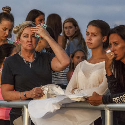 People gather during a candlelight vigil Monday for teenagers Austin Stephanos and Perry Cohen in Jupiter, Fla.