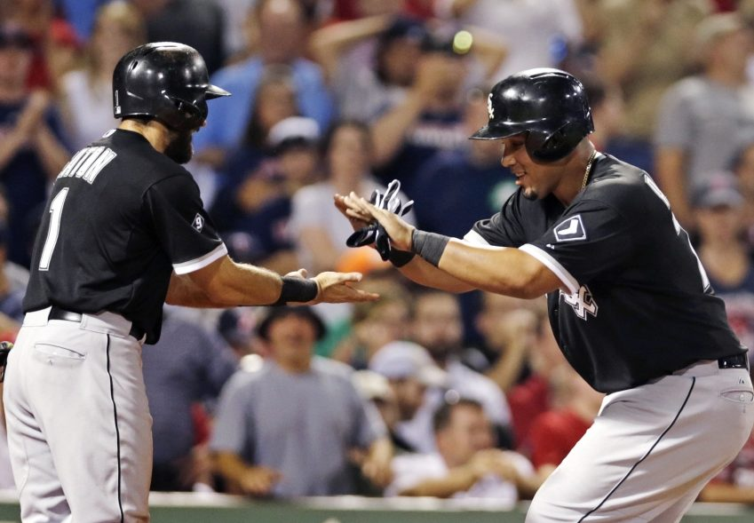 Chicago's Jose Abreu, right, is congratulated by teammate Adam Eaton after his two-run home run off Red Sox starter Wade Miley on July 28, 2015.