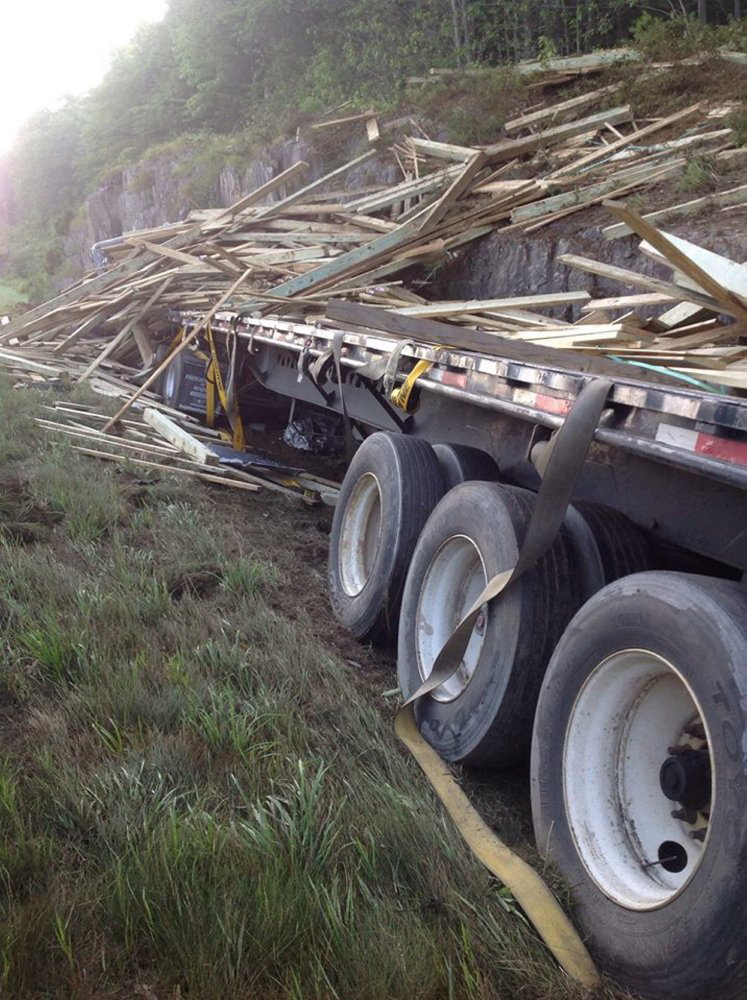 Lumber was spilled along the side of Interstate 95 northbound early Wednesday morning after a tractor-trailer crash.