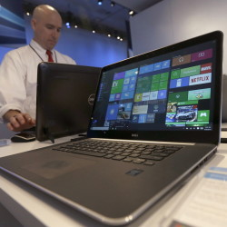 The new Windows 10 operating system debuted Wednesday as Microsoft tries to carve out a new role in a world that increasingly relies on smartphones, tablets and data stored online.
