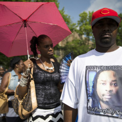 Bill Smith wears a shirt bearing the likeness of Samuel DuBose as he waits in line outside funeral services for DuBose in Cincinnati on Tuesday. DuBose was fatally shot by a University of Cincinnati police officer who stopped him on July 19 for a missing license plate.