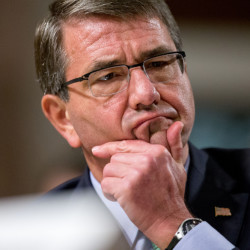 "Defense Secretary Ash Carter says that existing Pentagon policy gives commanders at U.S. installations ""the option of (employing) additional armed personnel."" The Associated Press"