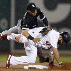 White Sox second baseman Carlos Sanchez falls after making the force-out against Red Sox first baseman Mike Napoli on a fielder's choice in the fourth inning at Fenway Park on Thursday.