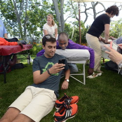 Ben Berman of Cape Elizabeth Snapchats with Micah Kogo of Kenya as Kogo gets a massage after the TD Beach to Beacon 10K press conference Friday. Berman's family often hosts elite runners for the Beach to Beacon. Shawn Patrick Ouellette/Staff Photographer