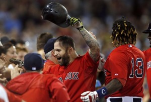 Mike Napoli celebrates his two-run home run in the seventh inning Friday night against the Tampa Bay Rays in Boston. The home run helped the Red Sox to a 7-5 win.