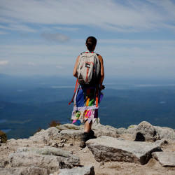 "Sarah Morse of North Berwick, who hiked the Appalachian Trail last year using the trail name ""Leap Frog,"" takes in the view near the summit of Mount Katahdin. This year, Baxter State Park is issuing permits to hikers who want to end the trek on Katahdin."