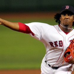 Listed at just 5 feet, 11 inches tall and 170 pounds, Pedro Martinez still managed to be a dominant pitcher during the steroid era. He had a record of 117-37 with the Red Sox. Paul J. Bereswill/Newsday