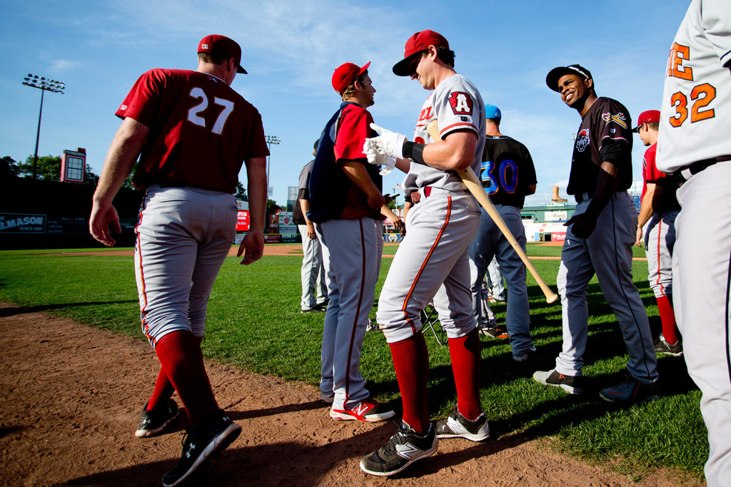 Dan Gamache of the Altoona Curve, center, takes off his batting gloves after winning the Home Run Derby before Wednesday's Eastern League All-Star Game at Hadlock Field.