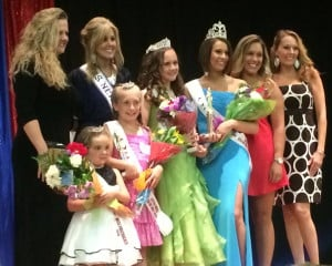 The winners of the Winslow Miss 4th of July pageant on stage Saturday, including Miss 4th of July Molly Lybrook, wearing the blue dress. It was later found that votes were tallied incorrectly and Lybrook didn't win. Organizers want Lybrook and the new winner, Caitlin Grenier, to share the crown, but Lybrook doesn't want to share it. Contributed photo