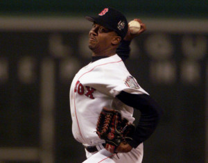 JULY 13, 1999: Chosen to start the All-Star game at Fenway Park, Martinez becomes the first pitcher to open an All-Star game with three straight strikeouts and fans five of six batters. Photos by The Associated Press