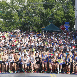 Runners take off at the start of the LLBean 4th of July 10k road race in Freeport. Jill Brady/Staff Photographer