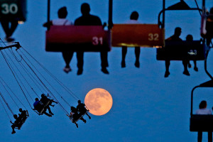JULY 1: The moon rises as people enjoy rides at the State Fair Meadowlands in East Rutherford, N.J.