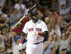 Red Sox designated hitter David Ortiz tosses the bat as he watches the flight of his three-run home run in the fifth inning against the Detroit Tigers at Fenway Park on Sunday,. The Associated Press
