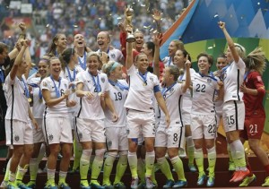 The United States Women's National Team celebrates with the trophy after they beat Japan 5-2 in the FIFA Women's World Cup soccer championship.