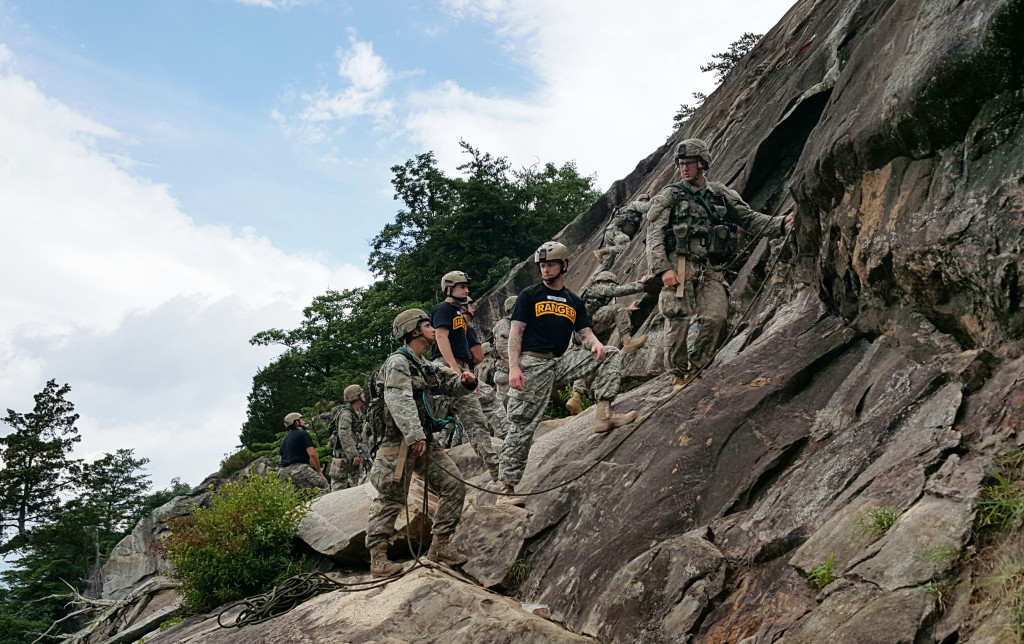 A two-person team of Ranger students, including a woman at left, receives guidance from a Ranger instructor on Mount Yonah in northern Georgia. Washington Post photo by Dan Lamothe