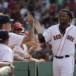 Hanley Ramirez is welcomed to the Red Sox dugout after hitting a two-run home run in the seventh inning against the Houston Astros at Fenway Park on Sunday. The Red Sox won 5-4. The Associated Press