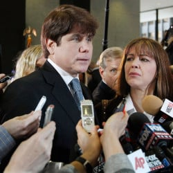 Former Illinois Gov. Rod Blagojevich, left, speaks to reporters as his wife, Patti, listens at the federal building in Chicago after Blagojevich was sentenced to 14 years on 18 corruption counts. The 7th U.S. Circuit Court of Appeals on Tuesday overturned some of the corruption convictions.