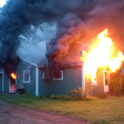 Fire rages through a home on Post Road in Bowdoinham on Thursday morning.