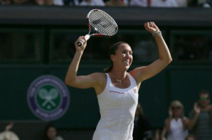 Jelena Jankovic of Serbia celebrates defeating Petra Kvitova of the Czech Republic in their singles match at the All England Lawn Tennis Championships in Wimbledon, London, on Saturday. The Associated Press