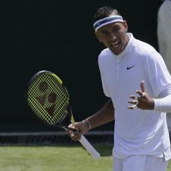 Nick Kyrgios of Australia gestures during the singles match against  Milos Raonic of Canada, during their singles match at the All England Lawn Tennis Championships in Wimbledon, London, Friday July 3, 2015. (AP Photo/Tim Ireland)