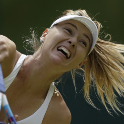 Maria Sharapova of Russia returns a ball to Coco Vandeweghe of the United States  during their singles match at the All England Lawn Tennis Championships in Wimbledon, London, Tuesday. The Associated Press
