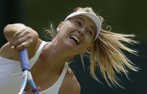 Maria Sharapova of Russia returns a ball to Coco Vandeweghe of the United States  during their singles match at the All England Lawn Tennis Championships in Wimbledon, London, on Tuesday. The Associated Press