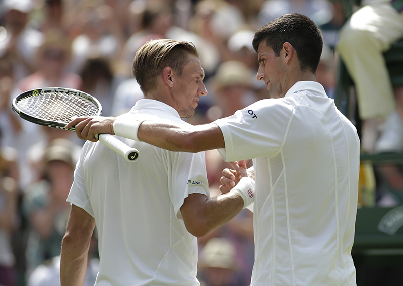 Novak Djokovic of Serbia, right embraces Jarkko Nieminen of Finland after their singles match at the All England Lawn Tennis Championships in Wimbledon.
