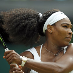 Serena Williams makes a return to Venus Williams  during their singles match at the All England Lawn Tennis Championships in Wimbledon, London, Monday. The Associated Press
