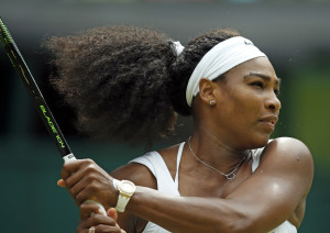 Serena Williams makes a return to Venus Williams  during their singles match at the All England Lawn Tennis Championships in Wimbledon, London, on Monday. The Associated Press