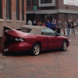The car hit the side of the Lafayette Building on Congress Street. Photo courtesy of WCSH6