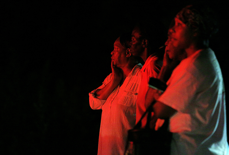 Bystanders watch as public safety personnel work at the scene of a fire at Mount Zion African Methodist Episcopal church in Greeleyville, S.C. The African-American church, which was burned down by the Ku Klux Klan in 1995, caught fire Tuesday night.