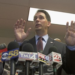 Wisconsin Gov. Scott Walker's three governor's races have left him with a far-reaching donor database of more than 300,000 names. The Associated Press