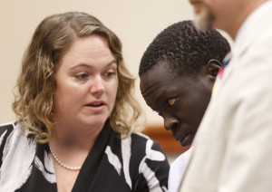 Gang Deng Majok confers with his attorney Kristine Hanley while being arraigned at Cumberland County Courthouse in Portland on Wednesday in connection with the killing of Treyjon Arsenault.
