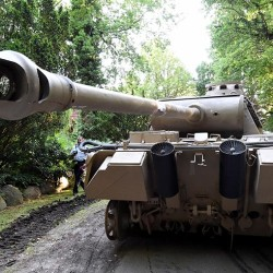 A  Nazi-era Panther tank  is prepared  for transportation from a residential property in northern Germany after authorities seized a cache of weapons from a collector's storage facility.