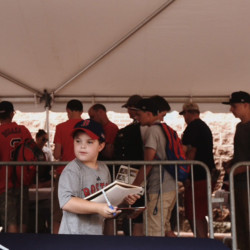 Kyle Hoffman, 8, holds a binder with baseball cards to be signed by players in the Eastern League All-Star game at Hadlock Field on Wednesday.