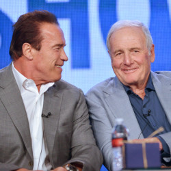 "Arnold Schwarzenegger, left, and Jerry Weintraub participate in a panel discussion at the Showtime Winter 2014 TCA Press Tour in Pasadena, Calif. Weintraub, who produced such hit movies as ""Nashville"" and ""Ocean's Eleven,"" died, Monday of cardiac arrest in Santa Barbara, Calif. He was 77. 2014 Associated Press file photo"