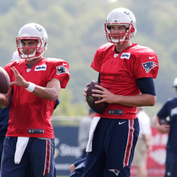 Tom Brady, right, gets set to run a drill with backup quarterback Jimmy Garoppolo in training camp Thursday. The Associated Press