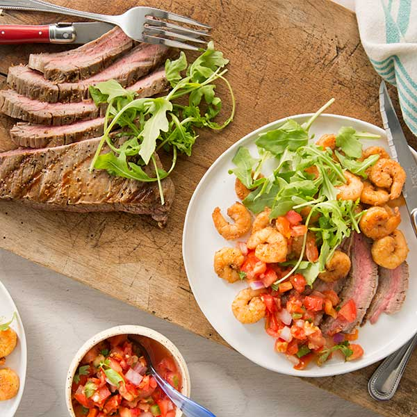 With Lighthouse Selections' protein-packed, chili-lime marinated shrimp and a lean cut of steak, this tender, deliciously coastal Spicy Surf & Turf combo can be created in no time.