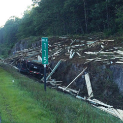 A tractor-trailer spilled its load of lumber on Interstate 95 in Sidney on Wednesday.