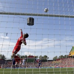 Japan goalkeeper Ayumi Kaihori makes a save against England in their semifinal in the FIFA Women's World Cup soccer tournament Wednesday in Edmonton, Alberta, Canada. The Associated Press