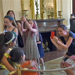 Visitors take photos while touring the White House  Wednesday. The Associated Press