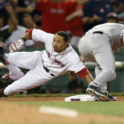 Boston Red Sox's Mookie Betts (50) is safe with a triple as New York Yankees' Chase Headley comes in late with the tag during the seventh inning of a baseball game in Boston, Saturday. The Associated Press