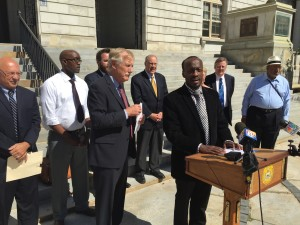 Senator Angus King stands with Philemon Dushimire, from Burundi in front of Portland City Hall on Friday morning.